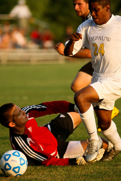 Freshman Shelton Graves fights the goalie for control of the ball  during DePauw's game against Holy Cross. The Tigers won 2-0 in the game August 29, 2008, at Bowman Field. Photo by Alex Turco