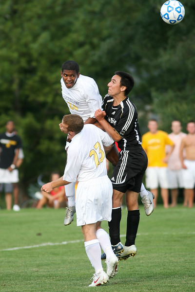 Freshman Shelton Graves and Senior forward Salvatore Greco fight a defender for a header during DePauw's game against Holy Cross. The Tigers won 2-0 in the game August 29, 2008, at Bowman Field. Photo by Alex Turco