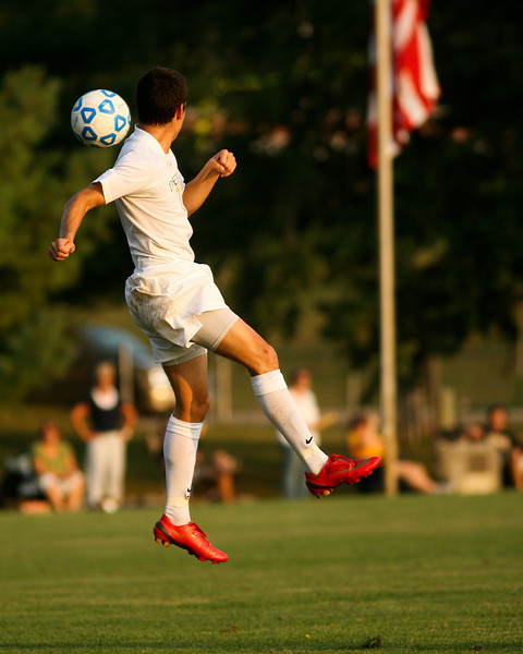Sophomore midfielder/forward Danny Witzerman jumps after a ball  during DePauw's game against Holy Cross. The Tigers won 2-0 in the game August 29, 2008, at Bowman Field. Photo by Alex Turco