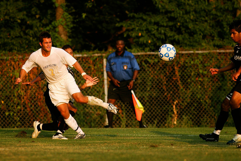 Senior midfielder Kaes Kamman makes a kick during DePauw's game against Holy Cross. The Tigers won 2-0 in the game August 29, 2008, at Bowman Field. Photo by Alex Turco