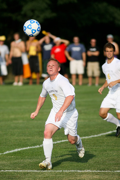 Senior forward Mike Harris chases down the ball  during DePauw's game against Holy Cross. The Tigers won 2-0 in the game August 29, 2008, at Bowman Field. Photo by Alex Turco