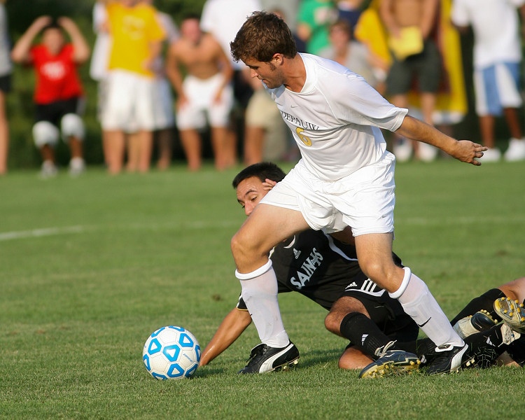 Sophomore midfielder Stephen Keller fights a defender for the ball  during DePauw's game against Holy Cross. The Tigers won 2-0 in the game August 29, 2008, at Bowman Field. Photo by Alex Turco