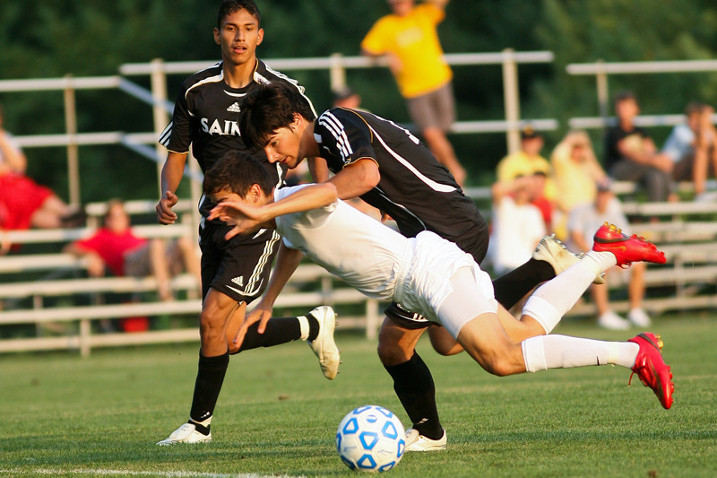 Sophomore midfielder/forward Danny Witzerman fights for the ball  during DePauw's game against Holy Cross. The Tigers won 2-0 in the game August 29, 2008, at Bowman Field. Photo by Alex Turco