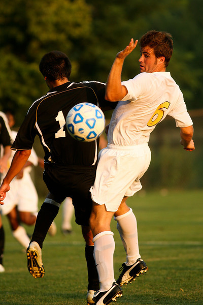 Sophomore midfielder Stephen Keller fights for the ball during DePauw's game against Holy Cross. The Tigers won 2-0 in the game August 29, 2008, at Bowman Field. Photo by Alex Turco