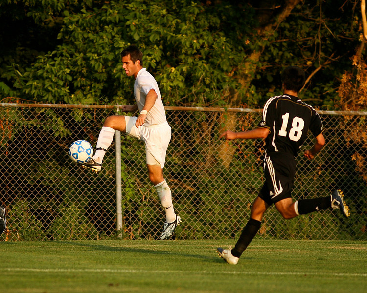 Senior midfielder Kaes Kamman jumps to make a kick during DePauw's game against Holy Cross. The Tigers won 2-0 in the game August 29, 2008, at Bowman Field. Photo by Alex Turco