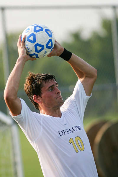 Junior midfielder Beau Sorg throws the ball in  during DePauw's game against Holy Cross. The Tigers won 2-0 in the game August 29, 2008, at Bowman Field. Photo by Alex Turco