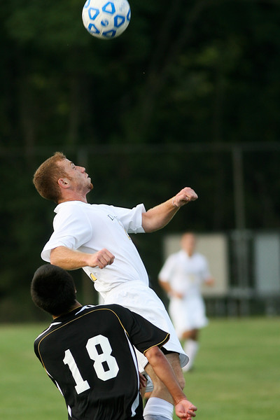 Senior forward Salvatore Greco fights for the ball  during DePauw's game against Holy Cross. The Tigers won 2-0 in the game August 29, 2008, at Bowman Field. Photo by Alex Turco