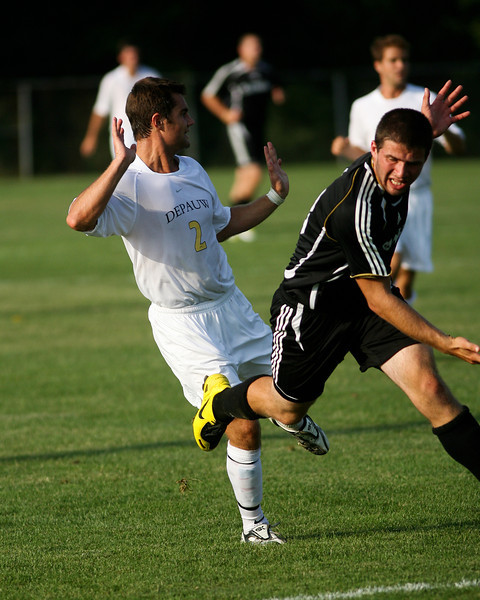 Senior midfielder Kaes Kamman reacts as he comes into contact with a defender  during DePauw's game against Holy Cross. The Tigers won 2-0 in the game August 29, 2008, at Bowman Field. Photo by Alex Turco