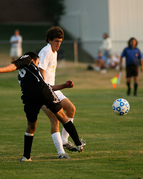Freshman midfielder Michael Pavell fights a defender for the ball during DePauw's game against Holy Cross. The Tigers won 2-0 in the game August 29, 2008, at Bowman Field. Photo by Alex Turco