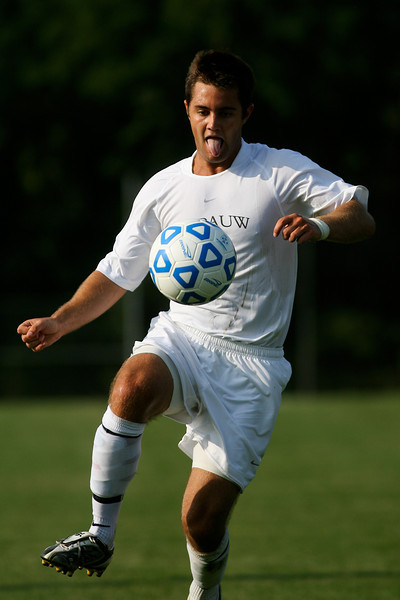 Senior midfielder Kaes Kamman chases the ball during DePauw's game against Holy Cross.  The Tigers won 2-0 in the game August 29, 2008, at Bowman Field.