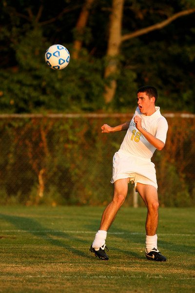 Freshman midfielder Matt Brown reacts after making a kick during DePauw's game against Holy Cross. The Tigers won 2-0 in the game August 29, 2008, at Bowman Field. Photo by Alex Turco