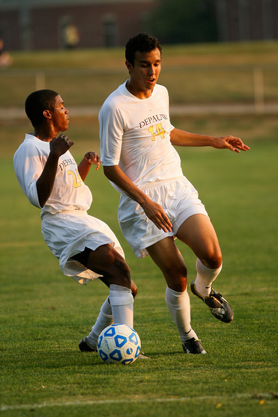 Freshman Shelton Graves and sophomore midfielder/forward Eric Witzerman move the ball down the field during DePauw's game against Holy Cross. The Tigers won 2-0 in the game August 29, 2008, at Bowman Field. Photo by Alex Turco