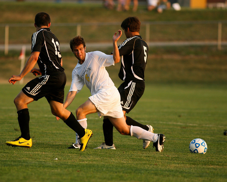 Sophomore midfielder Stephen Keller fights defenders for the ball during during DePauw's game against Holy Cross. The Tigers won 2-0 in the game August 29, 2008, at Bowman Field. Photo by Alex Turco
