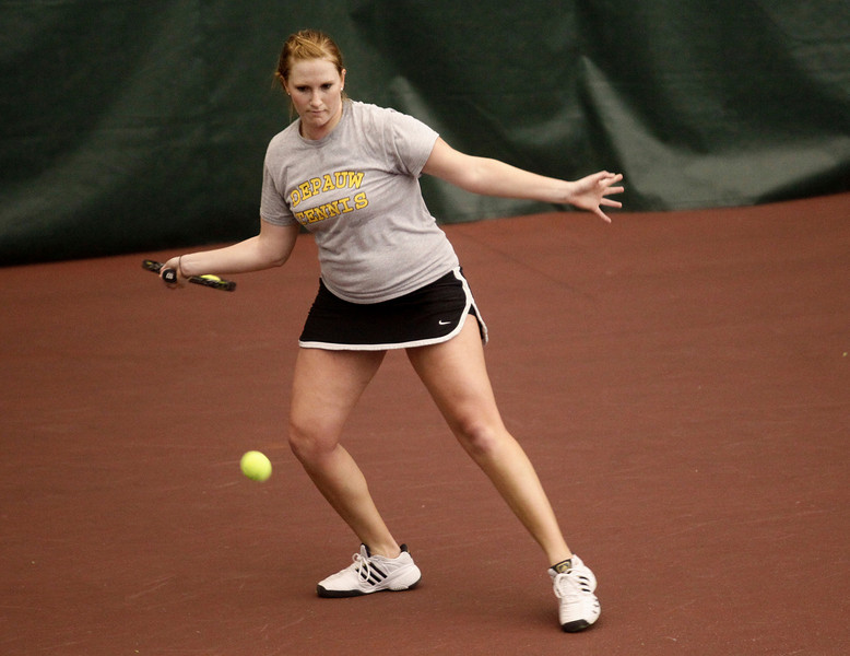 Senior Greer Mackie hits the ball during Indoor Nationals on Friday afternoon at the Indoor Track and Tennis Center. Alex Turco/The DePauw