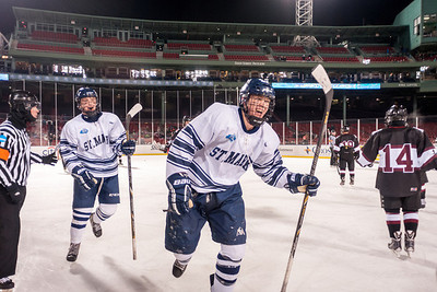 St. Marks vs Groton Frozen Fenway Hockey. 1/8/2014. St. Mark's players celebrate the winning goal in the 3rd Period.