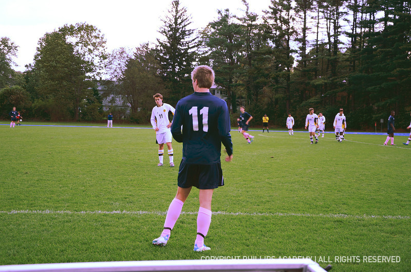 Sam Hewat '12 sports his pink socks on the sidelines.