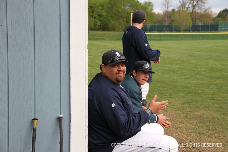 Assistant coach Chris Capano smiles for the camera.
