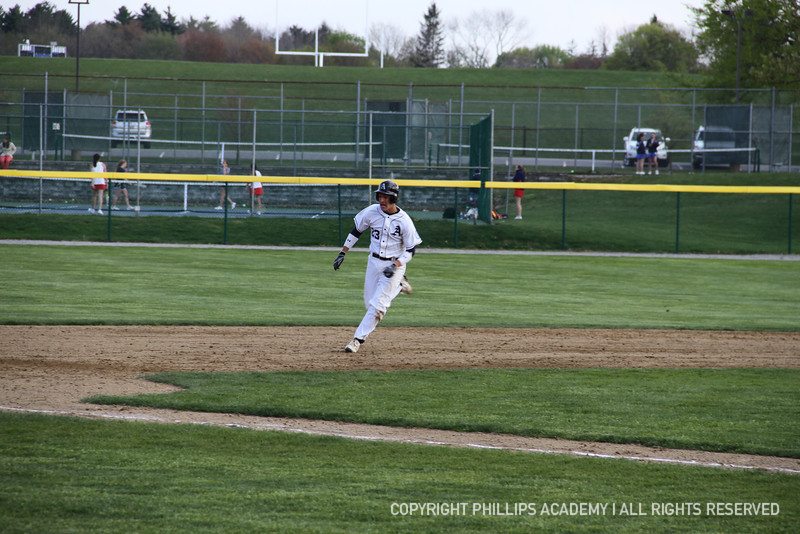 Chris Hohlstein '14 sprints to third on a solid hit by his teammate.