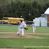 Dymecki '12 pushes off the mound to strike out the batter.