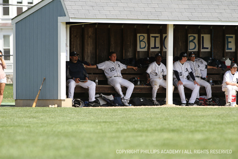 Corbin Lee '12 and teammates watch the Big Blue in action at the plate.