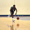 Labaron Sylvester '12 dribbles the ball up the court.