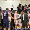 Thayer's head coaches shake hands with Palleschi '12.