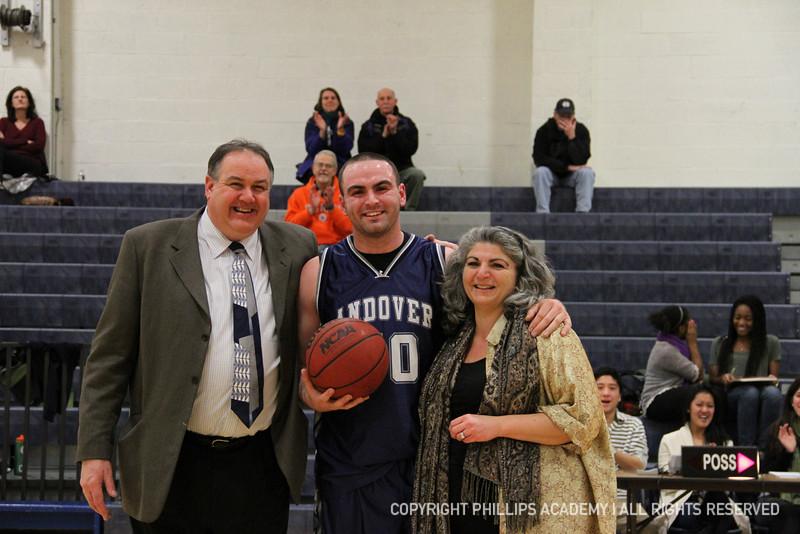 Co-captain Palleschi '12 and his parents after scoring his 1000 points.