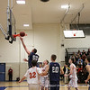 Co-captain Thomas Palleschi '12 takes a layup.