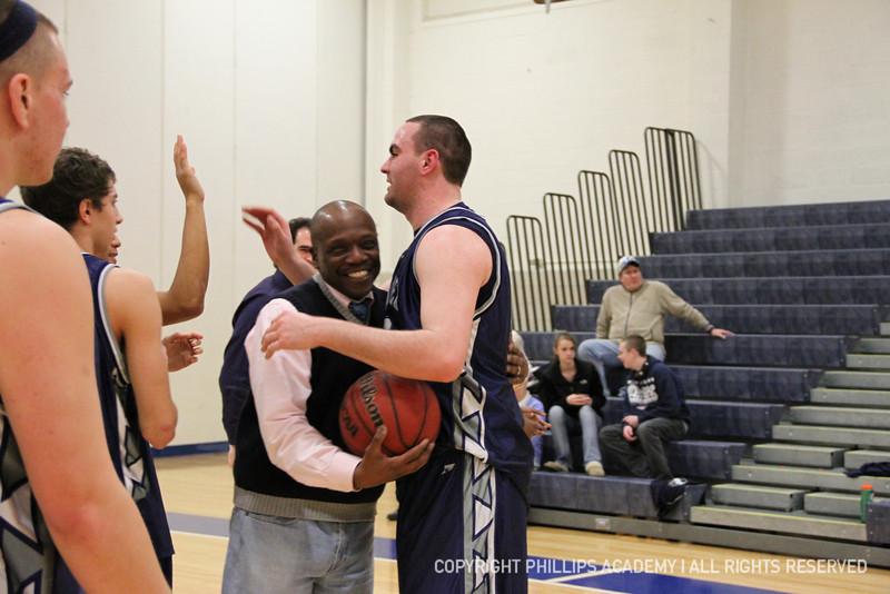 Coach Leon Modeste hugs co-captain Palleschi '12.