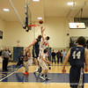Co-captain Thomas Palleschi '12 goes up for a rebound.