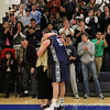 Co-captain Tom Palleschi '12 hugs his mother after scoring 1000 points.