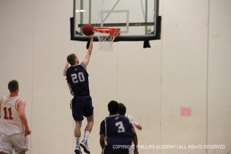 Co-captain Hartung '12 springs from the floor to make a great basket.