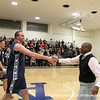 Coach Leon Modeste shakes hands with co-captain Palleschi '12.