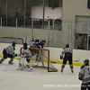 Luca Tresham '13 behind net, looks to pass the puck to an open teammate.