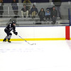 Connor Light '13 brings the puck down the ice.