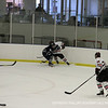 Andover crushes St. Seb's against the boards.