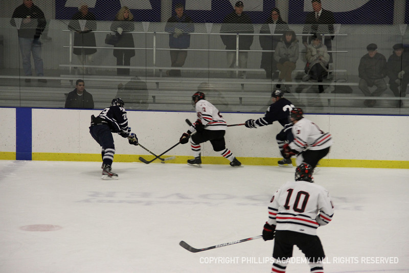 JB Cline '14 fishes the puck out from the boards.