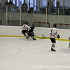 Thomas Shannon '12 beats St. Seb's to the puck.