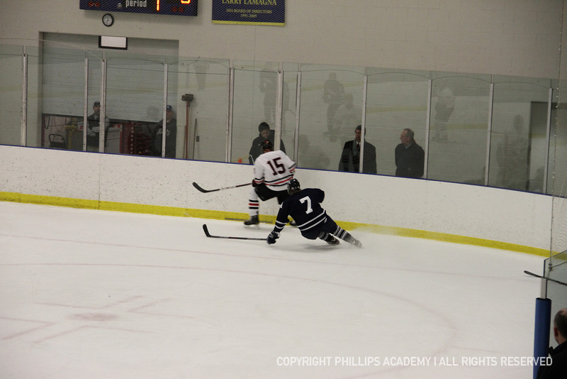 Jason Nawrocki '13 comes in hot to steal the puck from St. Seb's.