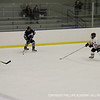Patrick Daly '15 looks to send the puck across the ice to an open teammate.