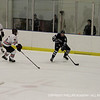Seamus O'Neill '13 gains control of the puck behind net and looks for an open teammate.