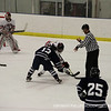 Zachary Weinger '15 takes a face off.