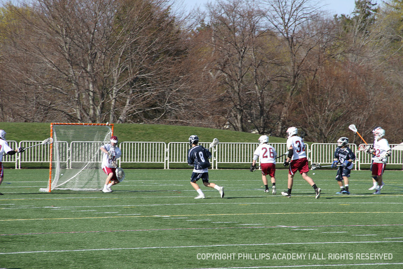 Timothy Bulens '15 takes a shot on net and scores.