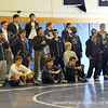 The Andover varsity boys' wrestling team intently watches a close match.