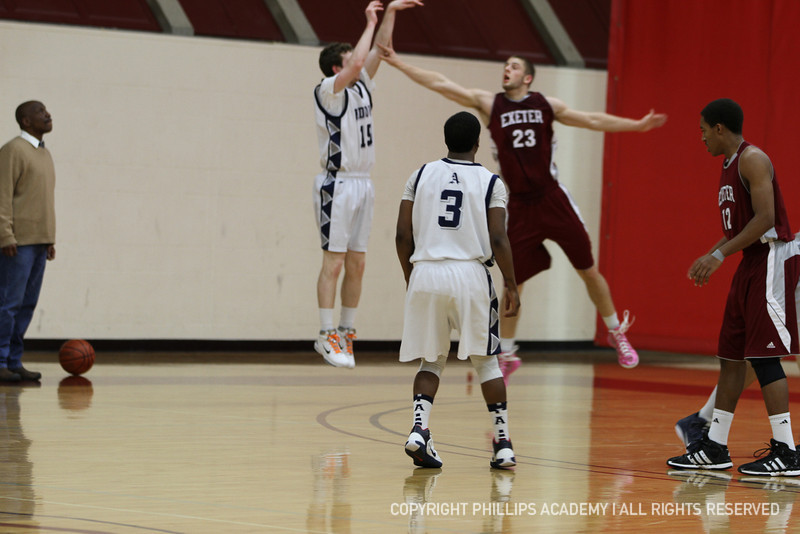 Brendan O'Connell '15 takes a 3 point shot while under pressure from Exeter.