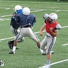 Varsity football candidates exercise some defensive skills during their preseason workouts.