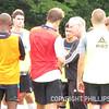 Boys varsity soccer Coach Bill Scott mentors his candidates during team huddle.