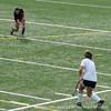 Field hockey candidates set up in stations during preseason tryouts.