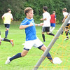 A boys soccer candidate takes a shot on net.