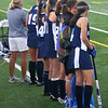 On the sideline, the girls in blue cheer on their teammates.